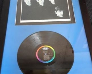 Framed Beatles album and cover.
