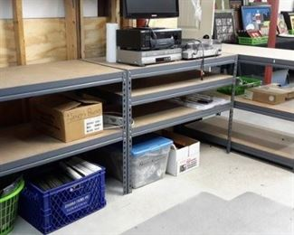 Metal and wood shelving, varying sizes.