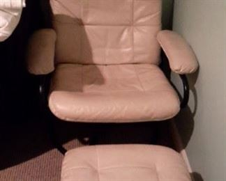 Cream colored leather swivel chair and ottoman, in great shape.