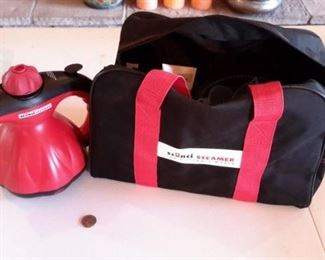Scuncii portable steamer with accessories and carry case, like new.