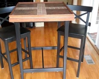 Tiled pub table and 2 chairs.