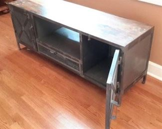 Rustic tv stand/entertainment center. Wood with metal doors.
