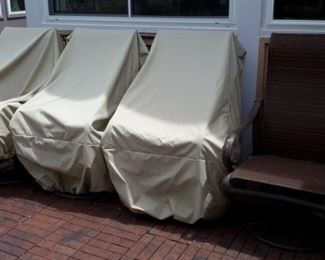 4 rocker/swivel patio chairs with like-new strap-down covers that won't blow away!