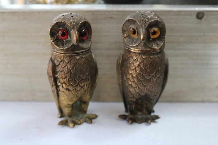 brass pair of table shakers with glass eyes