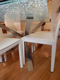 Chrome base to this fabulous dining room table. Excellent condition and a great modern look!