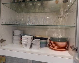 Kitchen cabinets full of dishware and items used while entertaining.