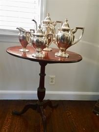 Antique accent table and silver plated tea set
