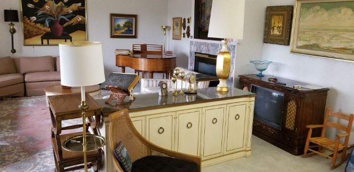 Mid-century furniture and baby grand piano.