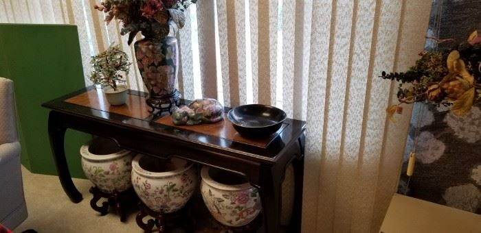 Oriental table, fish bowls, accessories.