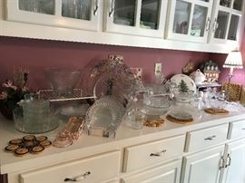Many glass serving dishes and other glassware, perfect for entertaining.