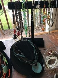 Costume jewelry: necklaces, bracelets, pins, and rings