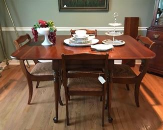 Sold cherry vintage dining. This petite set will fit almost anywhere—table with one leaf, 4 chairs, china cabinet.