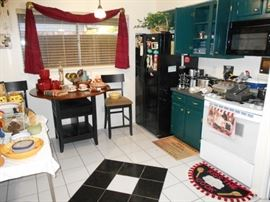 very cute kitchen items with bar height table and chairs
