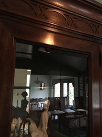 Accented-designed crown molding and beveled glass are only a few mentionables of the wall unit.