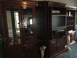 5 piece fine quality wood wall unit by Thomasville.  Featuring  beveled glass-front doors and glass shelving with ample cabinets for storage. Versatile ways to use as one large unit or section off for different usages in other rooms of the home.