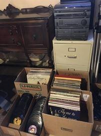 A few hundred of 45's and record albums sampler: Willie Nelson, Tony Bennett, Dwight Yoakam, Ricky Skaggs, Motown, etc. Stereo equipment, file cabinet,