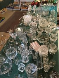 Crystal, of bowls, servers, vases, glassware, candle holders and etc. are bountiful.