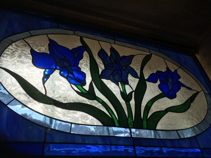 As captured of the blues of spring irises in bloom -stained glass window panel.