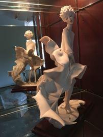 "Guisseppe Armani's ""The Umbrella Autumn"" figurine."