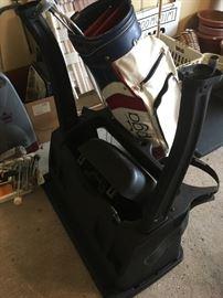 Golf bag holder for the back of golf cart.