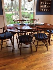 Table, leaf, 6 chairs (2 captain) and pads.  Pennsylvania House.