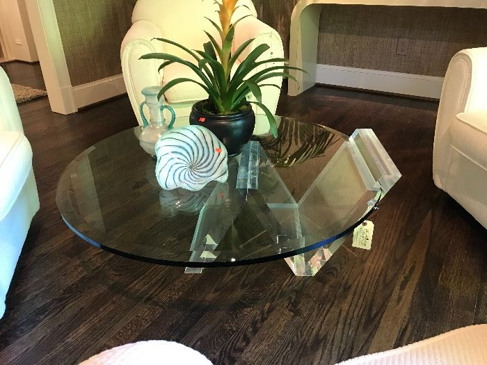 Stunning lucite cantilever coffee/cocktail table with round beveled glass.