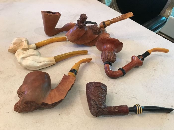 Collection of carved wood and bone pipes.