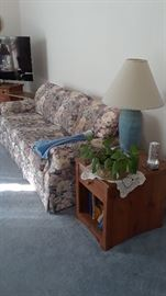 Floral sofa and set of side tables
