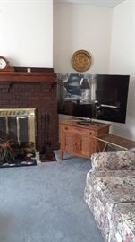 Flat screen tv on antique wash stand, sofa