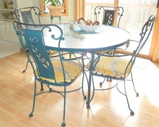 METAL GLASS TOP TABLE WITH - 4-  METAL CHAIRS AND CUSHIONS