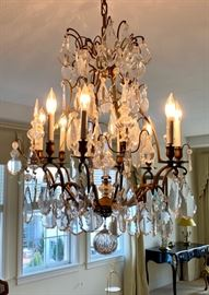 The crystal chandelier will be professionally uninstalled before the sale.