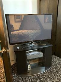 Flatscreen TV and Cabinet