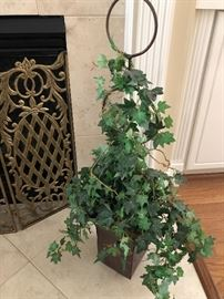 Topiary on the floor in front of the fireplace $36