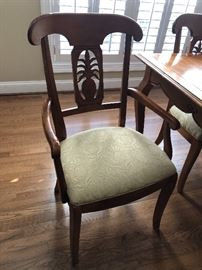 Super cute dining table with pineapple motif carved into the backs of each chair… $1100 for the Ethan Allen set...The fabric on the chairs even has a pineapple design
