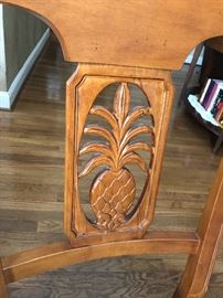 Close-up view of the pineapple motif dining chair