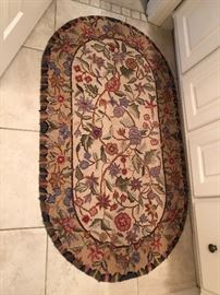 Floral loop rug $40...No other rugs in this house are for sale