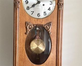 German wood case wall clock with time and strike.