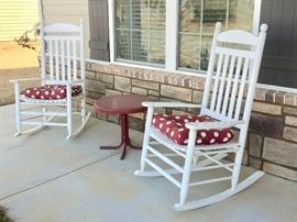 Comfortable wood rockers welcome all to the front porch.