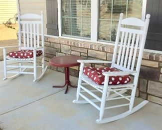 Comfortable wood rockers welcome all to the front porch.  Rockers sold, table available.