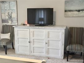 Marble-topped antique cabinet creates a beautiful dresser in the master bedroom.