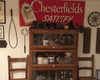 Antique Linen Chesterfield Sign, Antique Rug Beaters, Antique Rattan Chairs, Antique Lawyers Display Cabinet, Antique Sad Irons, & More!!!