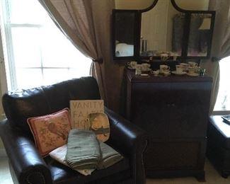 Leather Chair, Antique Dresser Mirror, Antique TV in Cabinet.