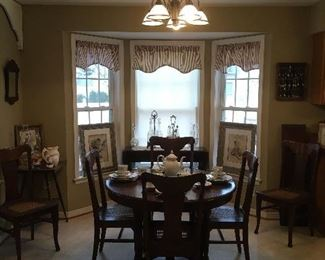 Antique Dining Room table with 2 leaves, Set of 6   cane antique chairs.