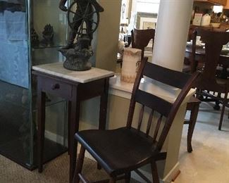 Small Marble top table, Bronze Ship Captain , Antique Plank Bottom Side Chair.