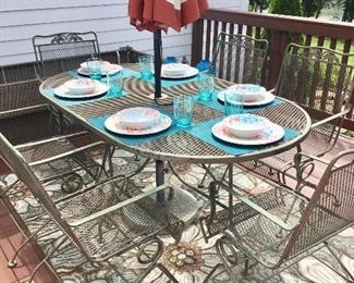 Umbrella table with six chairs