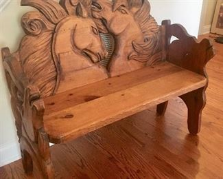 Carved horse bench