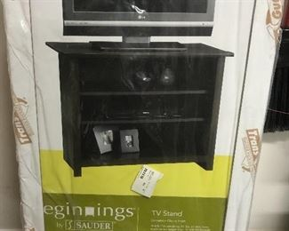 New in box black tv stand