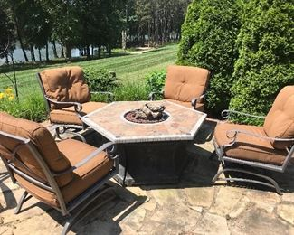 Gas fire pit and 4 chairs (priced separately)