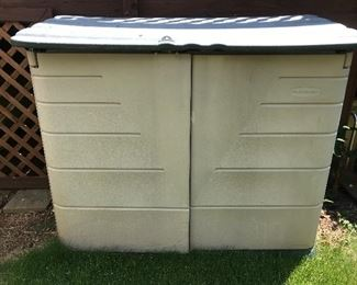 large plastic deck storage bin  (for cushions)