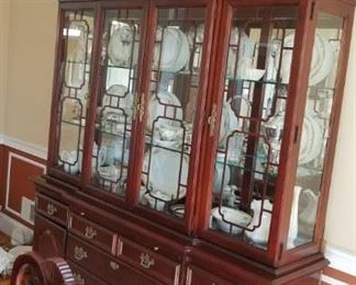2 piece china cabinet. Can remove the top, using the base as a server. Add some decorative feet and the top could be re-purposed into a great cabinet.